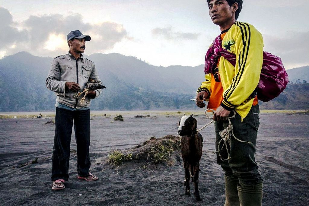 local people with offerings for the volcano
